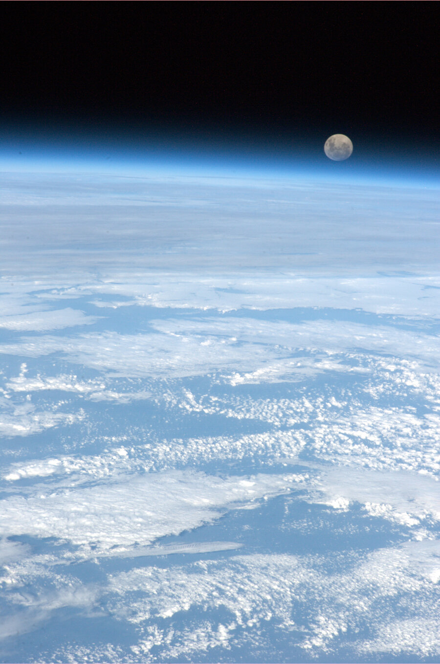 colchrishadfield:  The full moon rises over the only planet we have ever called home.  Beautiful.