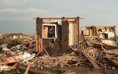"latimes:  A 'monster' tornado tears through central Oklahoma Though the death toll following one of the worst tornadoes in history has ticked down to 24 after reports yesterday said as many as 51 had been killed, the scene remains grim in Moore, Okla. Rescuers are still tearing through the wreckage, while President Obama assured those left standing after the storm that the nation will stand by them for ""as long as it takes."" Read more on the disaster here, and follow reporter Matt Pearce, who is reporting live from the tragic scene. Photos: Steve Gooch / Associated Press, Brett Deering, NOAA / AFP/Getty Images, Gene Blevins / Zuma Press / MCT"