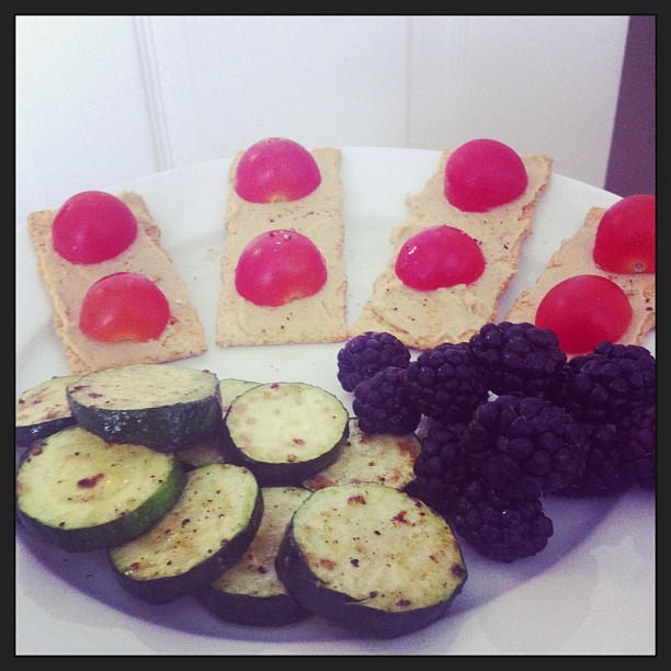 Wheat crackers with hummus and cherry tomatoes and a side of seasoned zucchini. Oh and blackberries 😍
