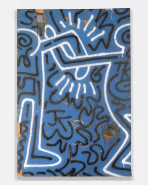 artnet:  Keith Haring, 1981 Here's some early morning Urban Art with the characteristic cartoon-like imagery of Keith Haring's iconic Street Art. The two figures with interlocked arms, one of the artist's familiar subjects, was spray painted on a large piece of plywood, which was once part of a construction fence.  Browse more art from the 80s East Village.