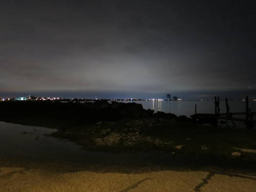 Midnight at The Breakwater Studio. Lake Pontchartrain began forming about 5,000 years ago when North American glacier melts caused the Mississippi River to swell and shift to the east. The river began depositing its sediments into the Gulf of Mexico, creating a broad delta which would later become Orleans, St. Bernard, and Plaquemines Parishes. The delta grew slowly eastward over 2,000 years and eventually separated a large body of water from the Gulf. Native Americans called this body of water 'Okwata' meaning 'wide water', and they dwelled peacefully on its shores for centuries. In 1699, Native Americans led the French settler, Pierre La Moyne, Sieur d'Iberville, on a journey through the area's Lakes and bayous. Iberville marveled at Okwata and renamed it Lake Pontchartrain, after the French Minister of the Marine at the time, the Comte de Pontchartrain. Lake Pontchartrain is just one part of a vast ecological system called the Pontchartrain Basin. Known for its slow flowing rivers and bayous, tranquil swamps, and lush hardwood forests, the Basin provides essential habitat for countless species of fish, birds, mammals, reptiles, and plants. The famous wetlands and marshes that surround the Basin's waters provide a beautiful setting for wildlife and are the heart of the region's commercial and recreational fisheries. The Pontchartrain Basin is also the center of southeastern Louisiana's unique cultural heritage. With almost 2.1 million residents, including rural farming communities, metropolitan New Orleans, and the fishing, shrimping, crabbing, and oyster industries, the area is brimming with a diversity of people bound by a common interest: the desire for clean and healthy waters in the Pontchartrain Basin.