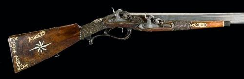 Very early over and under percussion sporting gun, Originally a flintlock converted into percussion, this odd firearm features over and under barrels, one below the other.  It has double triggers and and two separate percussion locks locks.  Unfortunately the listing does not specify caliber, so I don't know if it is a rifle or fowling piece. Dated 1800.