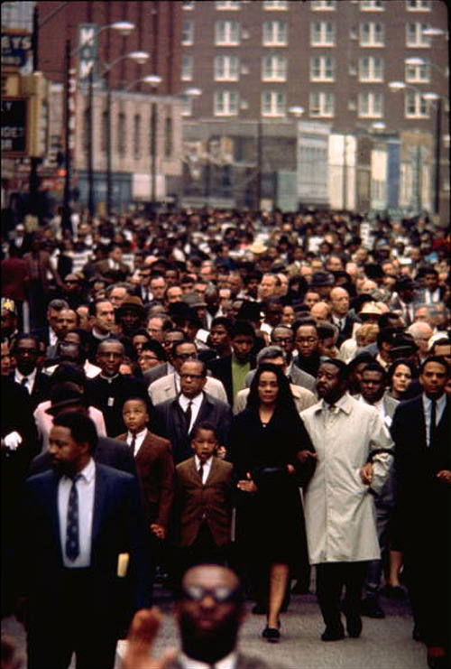 thats-the-way-it-was:  April 4, 1968: Civil rights leader, Rev. Martin Luther King Jr. is shot to death at a hotel in Memphis, Tennessee. A single shot fired by James Earl Ray from over 200 feet away at a nearby motel struck King in the neck. He died an hour later at St. Joseph's Hospital.  Photo: Ralph Abernathy, with Mrs. Martin Luther King and her children lead a massive march through through the streets of Memphis on April 8, 1968 (Art Shay/Time & Life Pictures/Getty)