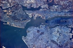 humansofnewyork:  Morning in NYC from the International Space Station, courtesy of Col. Chris Hadfield. Look at the shadow of Manhattan!