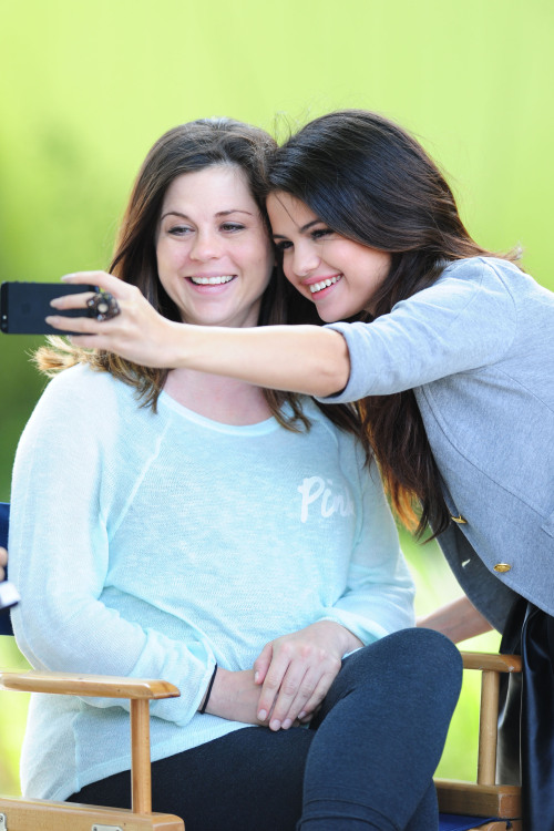 smg-news:  (HQ) Selena taking pictures with her mother backstage at her 'Dream Out Loud' commercial shoot!