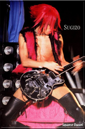 Today, we bring you more pictures from SUGIZO's pink hair days (and debatable choice of clothing, despite of how revealing it was)! We apologise for the quality of some images (there are a few which are really old and scavenged from Japanese Channel, for instance).