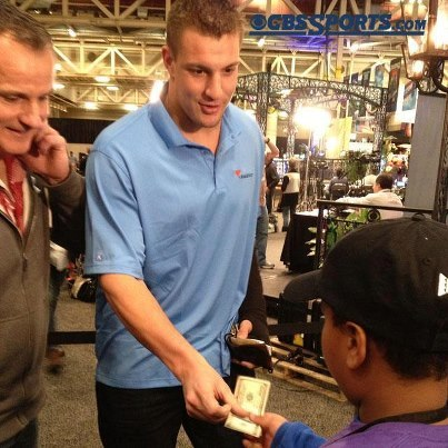 nflnewsandtalk:  -ROB GRONKOWSKI PAYS A KID $100 FOR LEMONADE AT SUPER BOWL-  Look, there aren't many words needed for this post. All you really need to know is that New England Patriots tight end Rob Gronkowski, who's wearing a big cast on his left arm, is at the Super Bowl.As he was leaving Radio Row, he ran into a small child selling lemonade. The kid asked him to purchase a drink, and he did just that. Except that he paid a little more than the drink actually costs, handing the kid a $100 bill and telling him to keep the change.That's what the Gronk is all about.