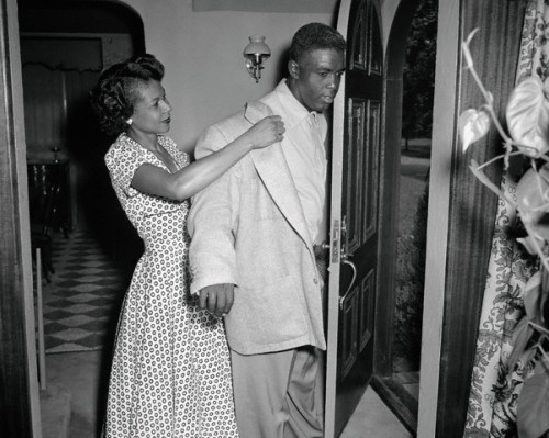 Baseball legend Jackie Robinson is helped into his jacket by his wife Rachel, circa 1950s, just before he leaves for the ball park. The Robinsons were married for 26 years before his death in 1972. Photo: Bettman/Corbis.