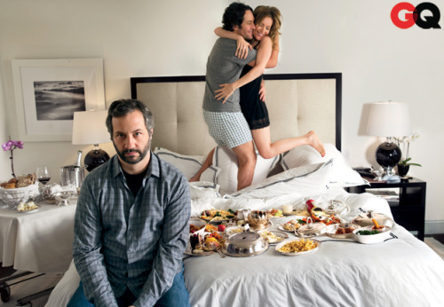 "Judd Apatow: ""The Best Idea I've Ever Had."" Is the reigning king of comedy jumping from the silver screen to…Broadway? Amy Wallace sits down with Judd Apatow and hears all about his (surprisingly mature) plans for the future.  Now, as the cameras roll, Fox and Mann chitchat with the hockey studs while Apatow calls out funny lines for them to say, many of which are being scribbled on Post-it notes by a circle of women who sit around him in director's chairs: Annie Mumolo, who co-wrote Bridesmaids, Paula Pell of Saturday Night Live, and Jenni Konner, who co-produces Girls. When it is discovered that one of the players has fake front teeth (and can remove them), Apatow yells out, ""Do you miss your teeth?""—and Fox spits the line right back. Though Rudd and Mann are reprising the roles, Pete and Debbie, that they played in Knocked Up, This Is 40 isn't a sequel exactly. It's more like a spin-off—""like Rhoda off of Mary Tyler Moore,"" Apatow says—in that it drops back in on the lives of two characters who played supporting roles in the first film. Ask Apatow why he has returned to familiar territory, and he says, ""I want to do the sequel of all of the movies I've made. Why wouldn't you do ten Superbads? Forget another one. I'd follow those guys every year for the rest of their lives.""  Read On"