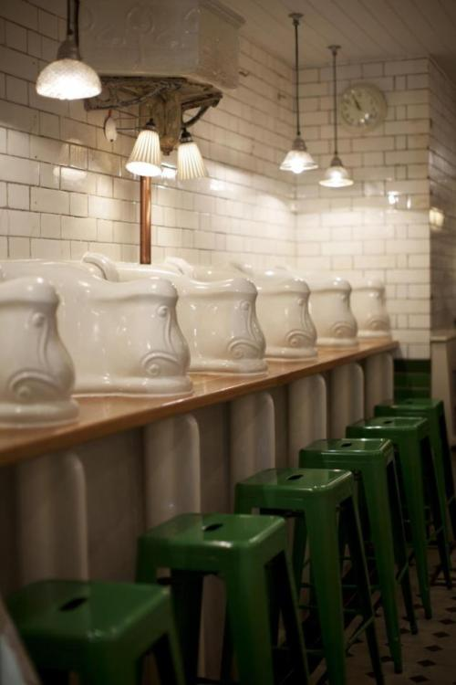 A 19th century men's restroom is a new restaurant called the Attendant.