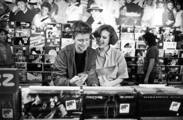 Anthony Michael Hall and Molly Ringwald in a record shop during a break while filming The Breakfast Club, 1984