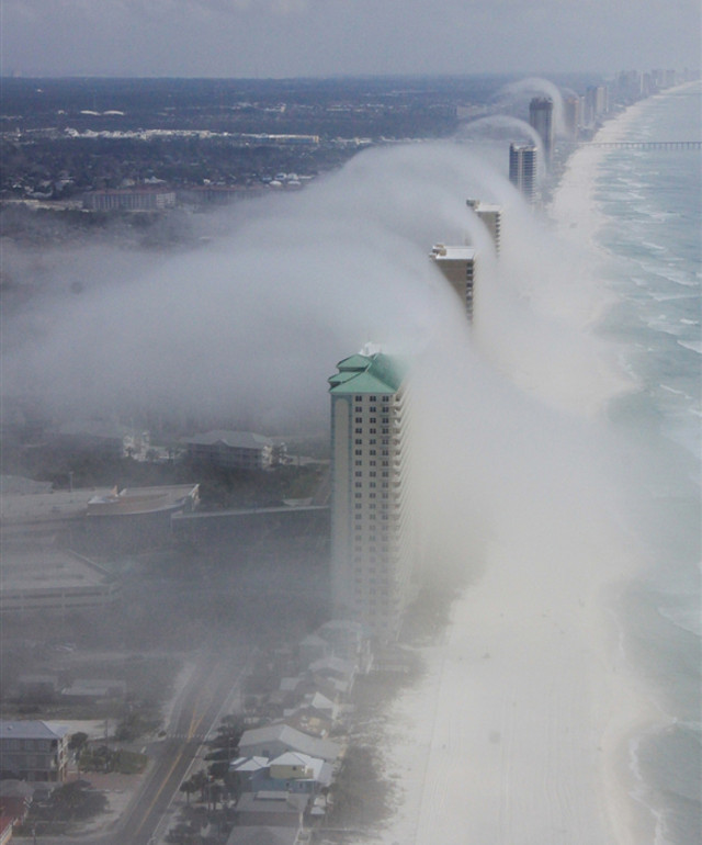 "tapejarascience:  A 'cloud tsunami' rolls over Panama City beach ""Meteorologist Dan Satterfield explains this occurrence on his blog:  Cool air offshore was very nearly at the saturation point, with a temperature near 20ºC and a dew point of about 19.5ºC. The air at this temperature can only hold a certain amount of water vapor, and how much it can hold depends heavily on the temperature. If you add more water into the air, a cloud will form, but you can also get a cloud to form by cooling the air. Drop the temperature, and it can no long hold as much water vapor, so some of it will condense out and a cloud will form."""
