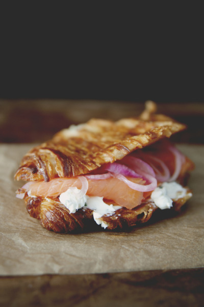 Griddled Croissant with Chive Cream Cheese, Smoked Salmon, and Pickled Onions