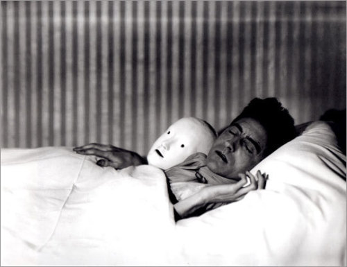 "maudelynn:  ""Cocteau in Bed with Mask."" by Berenice Abbott"