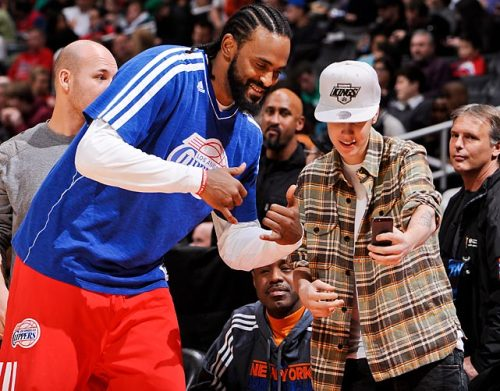 siphotos:  Ronny Turiaf and Justin Bieber share a moment during a Clippers-Celtics game late last month. (Andrew D. Bernstein/NBA Getty Images) GALLERY: Did You See That?