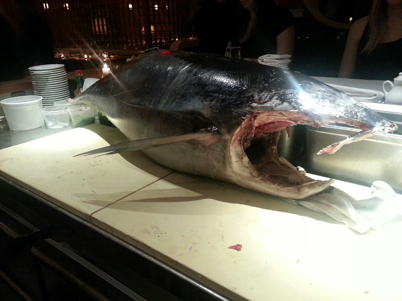 A 110 pound tuna just arrived, let the carving begin.