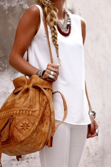 From the braid to the bag, this lady has serious steez.