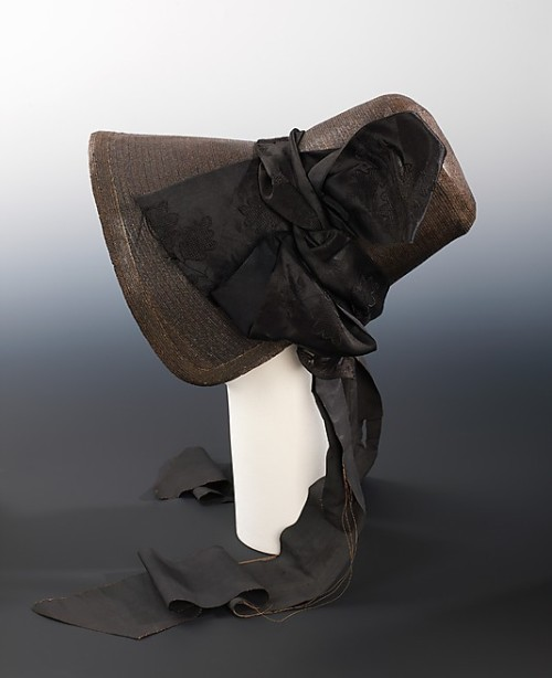 Mourning poke bonnet, ca 1840 US, the Metropolitan Museum of Art  The style of the poke bonnet manifests the demure and modest style that followed the young Queen Victoria's accession to the throne in 1838. This severe all-black example was probably worn for mourning, a long-standing custom that the Queen elevated to a social institution, especially after the death of her beloved husband, Prince Albert.