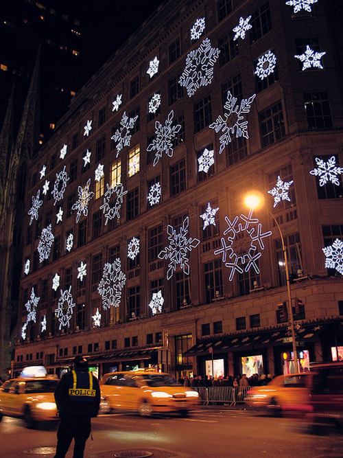 snowing plane-ticket:  Snowflakes on Saks Fifth Ave - NYC