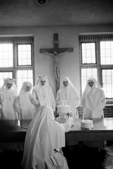 Nuns and Cake. Eve Arnold - A wedding cake for the Brides of Christ, Surrey, England, 1965.