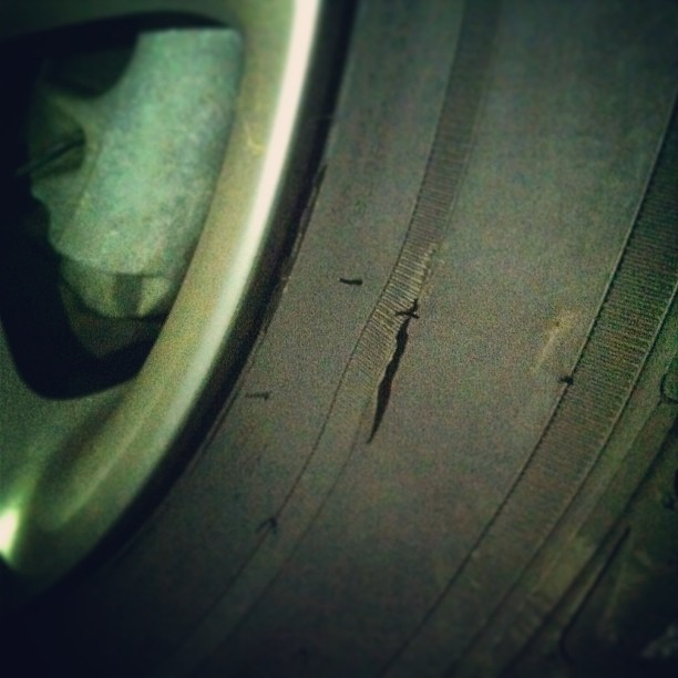 No this is not abstract art, it's my tire that was slashed last night in dt Carrollton while eating dinner on the square. If you have any leads, the police and I would love to know. #freakyfriday #seriously (at Carrollton's Adamson Square)