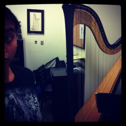 Playing the harp at skewlWell, taking pictures of it, anywayHahaMy fingers hurt!I've been practicing for 2 hours straight