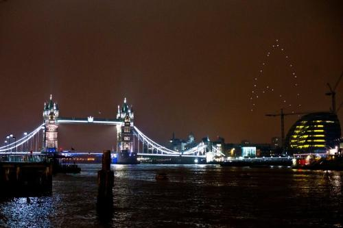 Drones form giant, glowing 'Star Trek' logo over London to promote Star Trek Into Darkness. The Verge:  a giant, glowing Starfleet insignia in the London night sky comprised of 30 LED-illuminated quadrotors, the 308-foot-tall logo rotated in place 118 feet above ground before dimming its lights alongside those of Tower Bridge and Big Ben in recognition of the WWF's Earth Hour conservation effort.  They also include a link to a video of the logo.