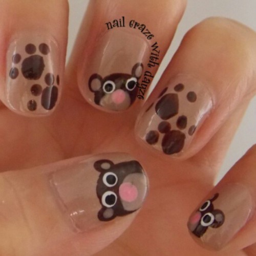 Teddy bear nail art with paw prints #nails #teddybearnails #teddybear #pawprint #cutenails #girly #instalike #instafollow #instagood #instagramhub #instamood #instamillion #instadaily #followers #follow #followme #shoutout #shoutouts #share #like #nailcrazewithdayze