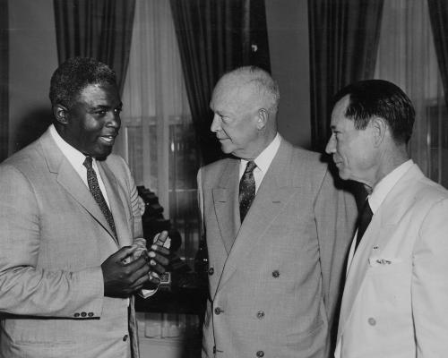 Baseball great, Jackie Robinson with President Eisenhower and comedian Joe E. Brown at the White House on May 14, 1957. -from the Eisenhower Library
