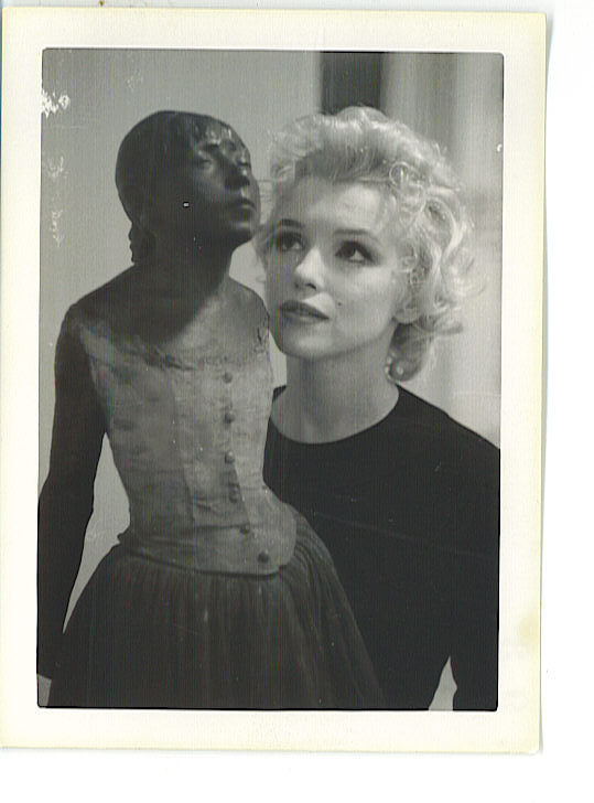 Marilyn Monroe photographed by Joshua Logan with Petite danseuse de 14 ans by Edgar Degas at William Goetz House in 1956