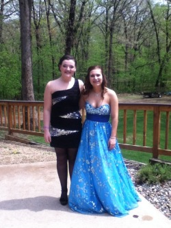 My bestie and i all dressed up fer prom. My dress is beautiful