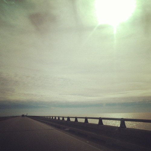 Sky was gorgeous today on my drive over :) #sky #clouds #sun #water #lake #nature #nola #bridge