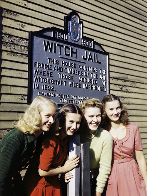 vintagegal:  Girls pose by a jail that recalls the witch trials of 1692 in Salem, Massachusetts. Photo taken in 1945.