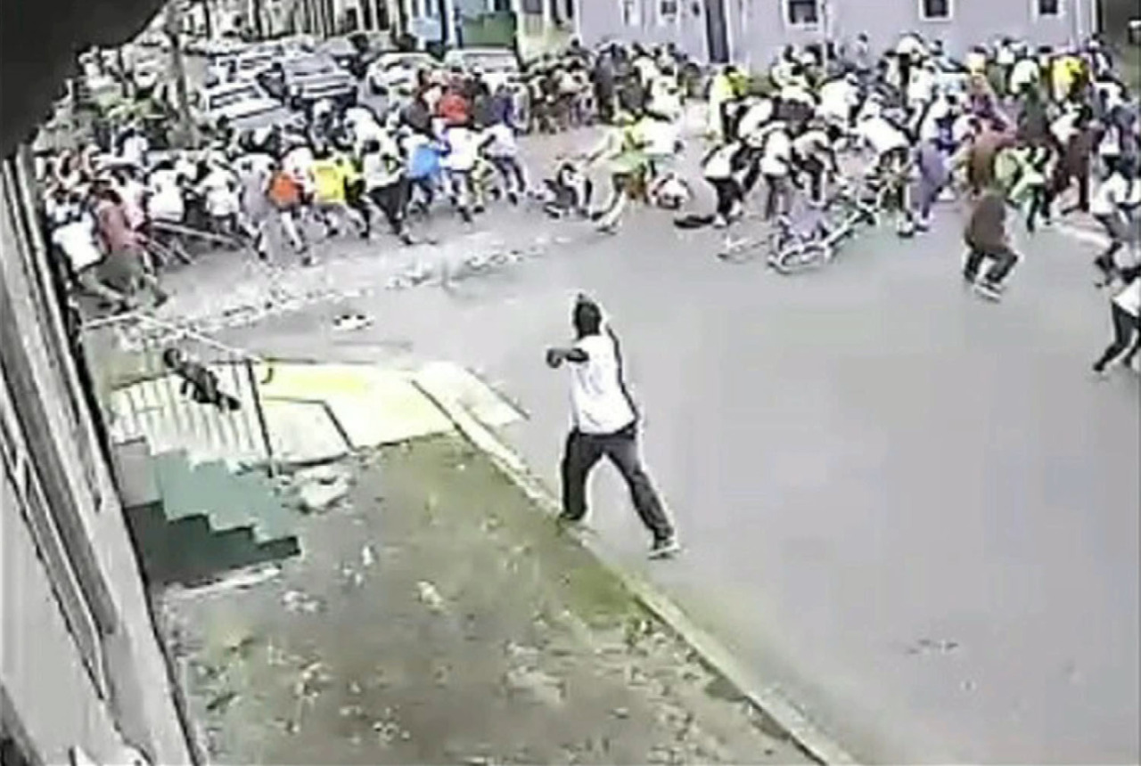 New Orleans Police Department release image of gunman shooting into crowd at Mother's Day parade New Orleans police searched on Monday for the gunmen who wounded 19 people, including two children, at a Mother's Day parade, a police spokesman said. Ten men, seven women, and a girl and a boy both age 10, were hit when gunmen opened fire at the parade on Sunday. Police said they were looking for three suspects, adding that a motive for the shooting was unknown.