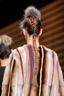 Sam McKnight affixed small pieces of dyed fur to the tops of french braids for Fendi, Fall 2013.