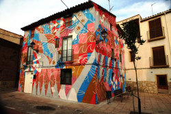 this house was painted for Avant- Garde Urbano festival held every year in Tudela de Navarra Spain.  2012 this town was voted one of the best street art cities in the world. artist: Joachim Ixcalli festival: Avant- Garde Urbano