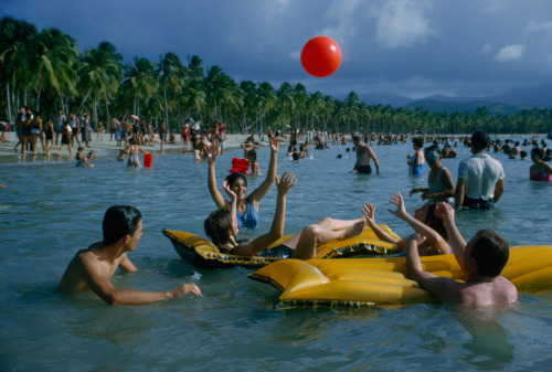 natgeofound:  People play in water off Luquillo Beach in Puerto Rico, December 1962.Photograph by B. Anthony Stewart, National Geographic