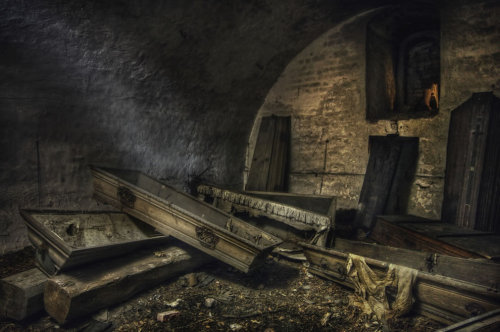 Abandoned Crematorium with Empty Coffins