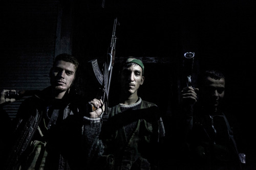 politics-war:  Syrian rebel fighters belonging to the Liwa Al Tawhid unit in the Karmal Jabl neighborhood after several days of intense clashes between rebel fighters and the Syrian army in Aleppo.