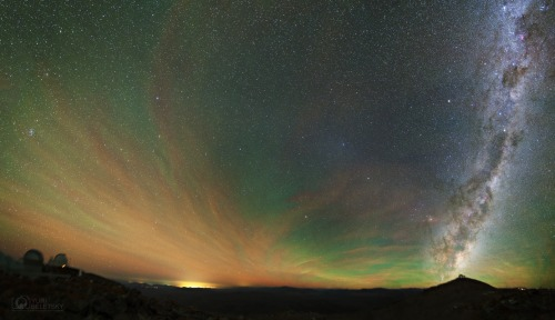 Airglow, Gegenschein, and Milky Way As far as the eye could see, it was a dark night at Las Campanas Observatory in the southern Atacama desert of Chile. But near local midnight on April 11, this mosaic of 3 minute long exposures revealed a green, unusually intense, atmospheric airglow stretching over thin clouds. Image Credit & Copyright: Yuri Beletsky (Las Campanas Observatory, Carnegie Institution) Unlike aurorae powered by collisions with energetic charged particles and seen at high latitudes, the airglow is due to chemiluminescence, the production of light in a chemical reaction, and found around the globe. The chemical energy is provided by the Sun's extreme ultraviolet radiation. Like aurorae, the greenish hue of this airglow does originate at altitudes of 100 kilometers or so dominated by emission from excited oxygen atoms. The gegenschein, sunlight reflected by dust along the solar system's ecliptic plane was still visible on that night, a faint bluish cloud just right of picture center. At the far right, the Milky Way seems to rise from the mountain top perch of the Magellan telescopes. Left are the OGLE project and du Pont telescope domes.