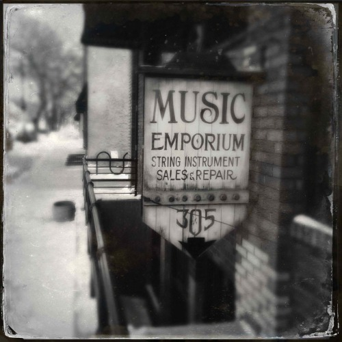 """Music Emporium""   For your daily dose of Hipstamatic this image of the Music Emporium just off Broadway in downtown Fargo North Dakota.  I used the 1884 Tinto lens and D plate film to give it an old time effect. Hipstamatic 262, 1884 Tinto lens and D Plate Film, no flash."