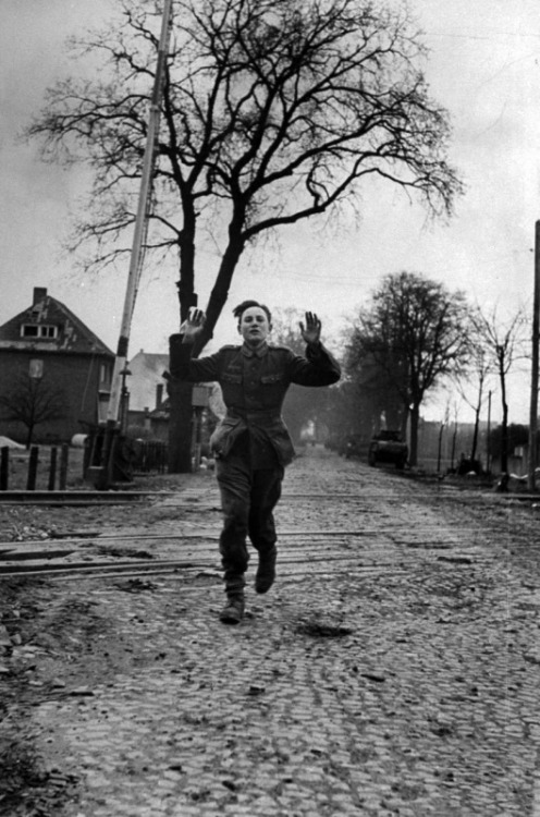 demons:  A young German POW running down the streets of Lemgo, Germany 1945
