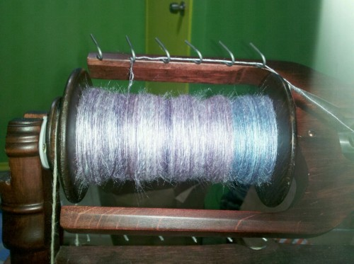 Spinning up some tussah in between laundry loads.
