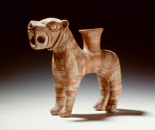ancientpeoples:  Rhyton (offering vase) in shape of a lion Middle Bronze Age, found in Turkey This vase is made from earthware and is painted with red, yellow and black. Geometrical decoration is similar to earthware from earlier earthware from same geographical location.  (Source: The Leiden Museum of Antiquities)