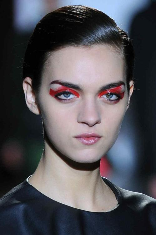 Eerie red brushed eye make-up at #CédricCharlier #PFW