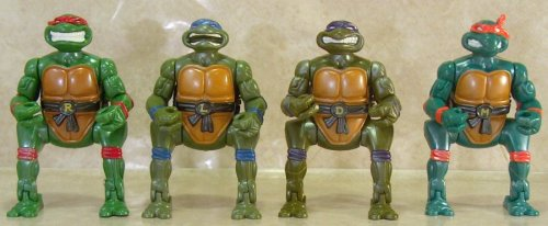 This picture made me laugh way too much. These constipated Ninja Turtle figures were produced by Playmates in 1994.  They broke out of plastic eggs by snapping upward from a crouching position, hence the strange legs.