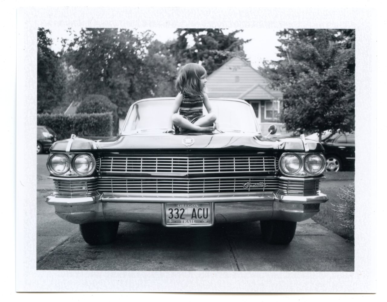 Chilling on Dad's Caddy. Portland, OR | 2013