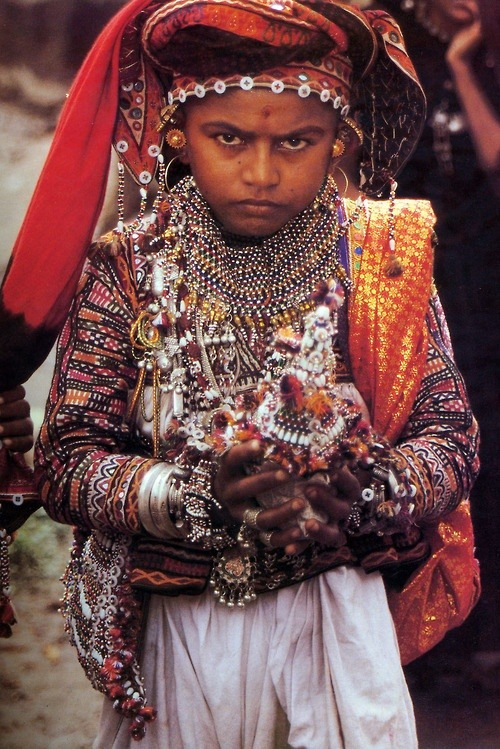 "Rabari groom carrying a coconut | Image taken from the publication ""Dowries for the Kutch"" by Vickie C Elson"
