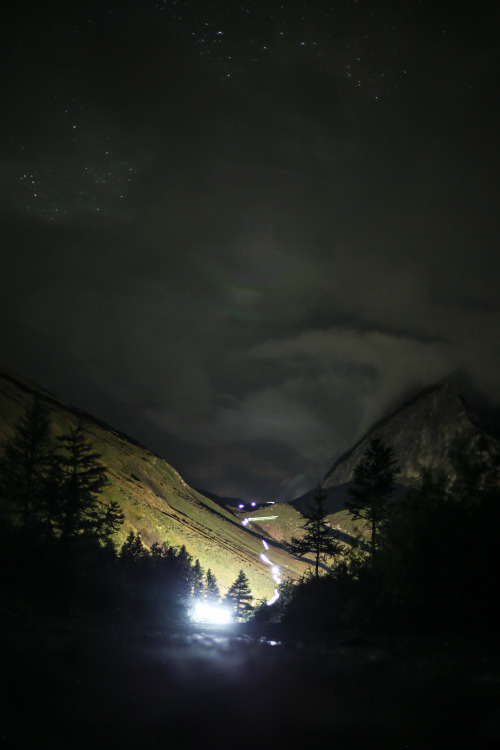 Runners light up the night above Lac Combal during the Ultra-Trail du Mont-Blanc.Photo: Kirsten Kortebein
