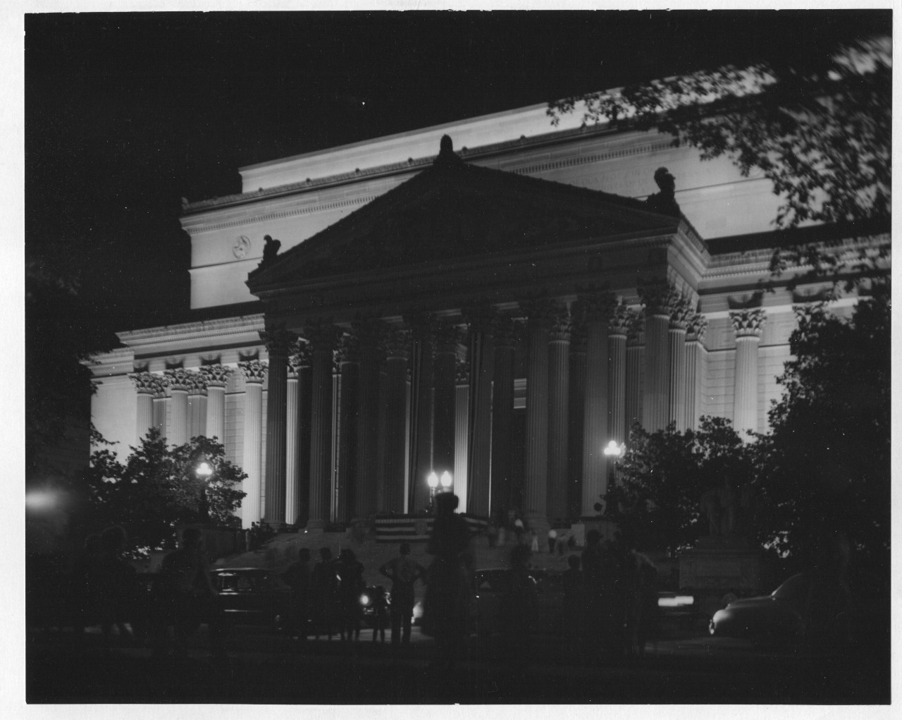 """Good night, usnatarchives!  Photograph of the National Archives Building Lit Up at Night, 08/29/1954 From the series:Historic Photograph File of National Archives Events and Personnel, 1935 - 1975  The National Archives Building as it appeared 60 years ago in 1954. We recently celebrated our 80th birthday with the anniversary of the """"National Archives Act"""" on June 19, 1934. More from the #Archives80 celebration →"""